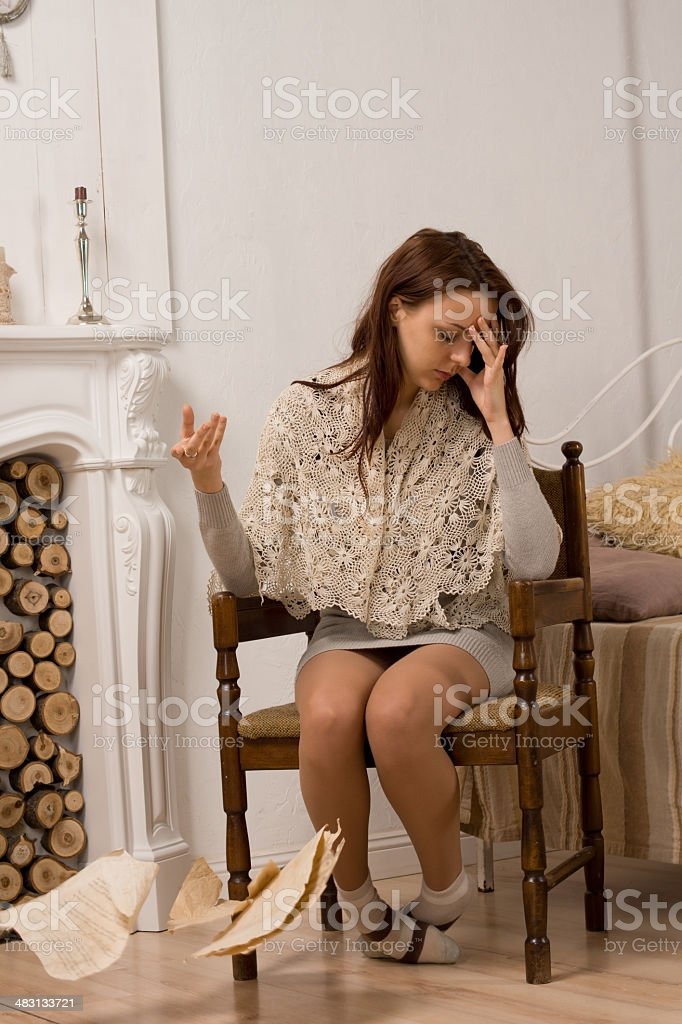 Distraught young woman dropping a document royalty-free stock photo