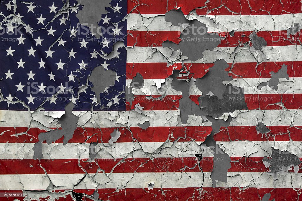 Distressed Chipped American Flag on concrete stock photo