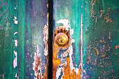 Distressed Old Green Wood Door and Modern Lock (Close-Up)