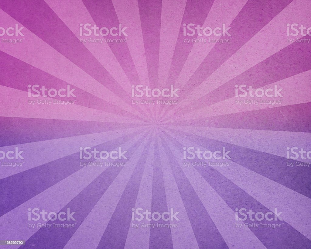 distressed pink and purple paper with light rays stock photo