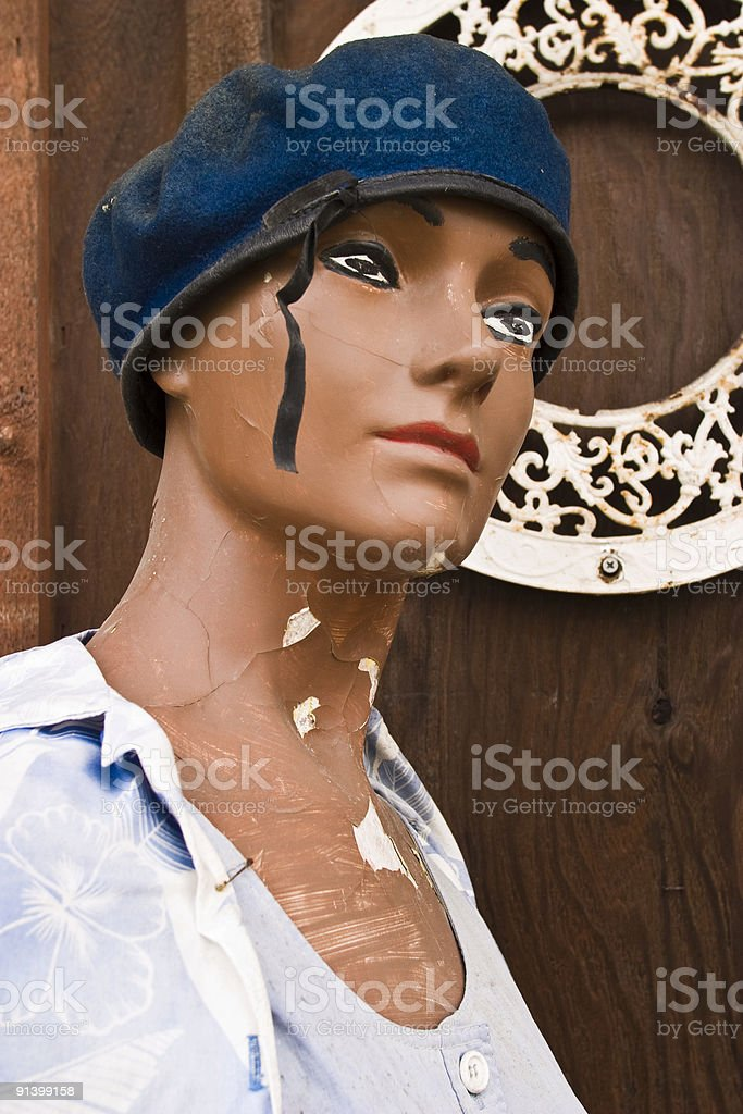 Distressed Retail Mannequin, Left Outdoors, Wearing Beret, Female royalty-free stock photo