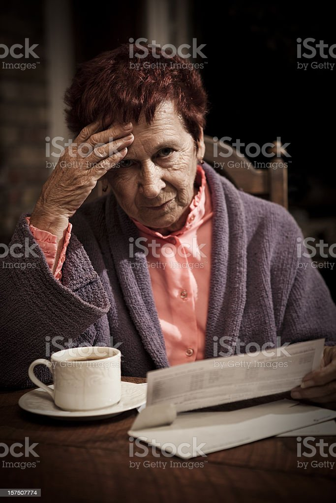 Distressed Senior Woman with Bills royalty-free stock photo