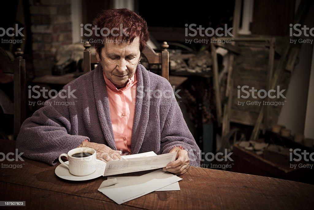 Distressed Senior Woman with Bills stock photo