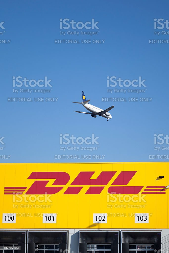 DHL distribution and logistics center, landing airplane royalty-free stock photo