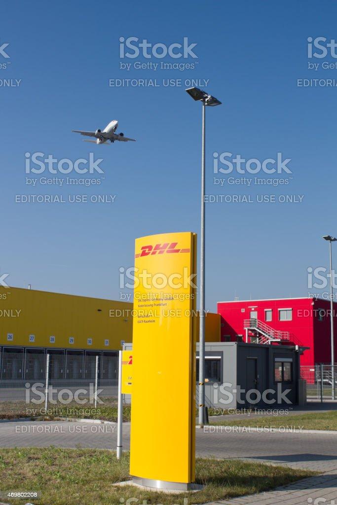 DHL distribution and logistics center, landing airplane stock photo