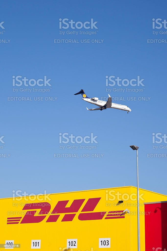 DHL distribution and logistics center, landing airplane stock photo