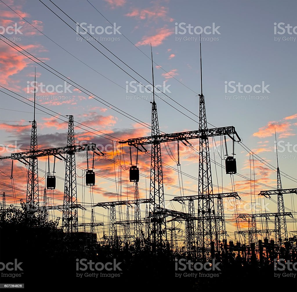 distribution electric substation pylon with lines, at sunset. stock photo