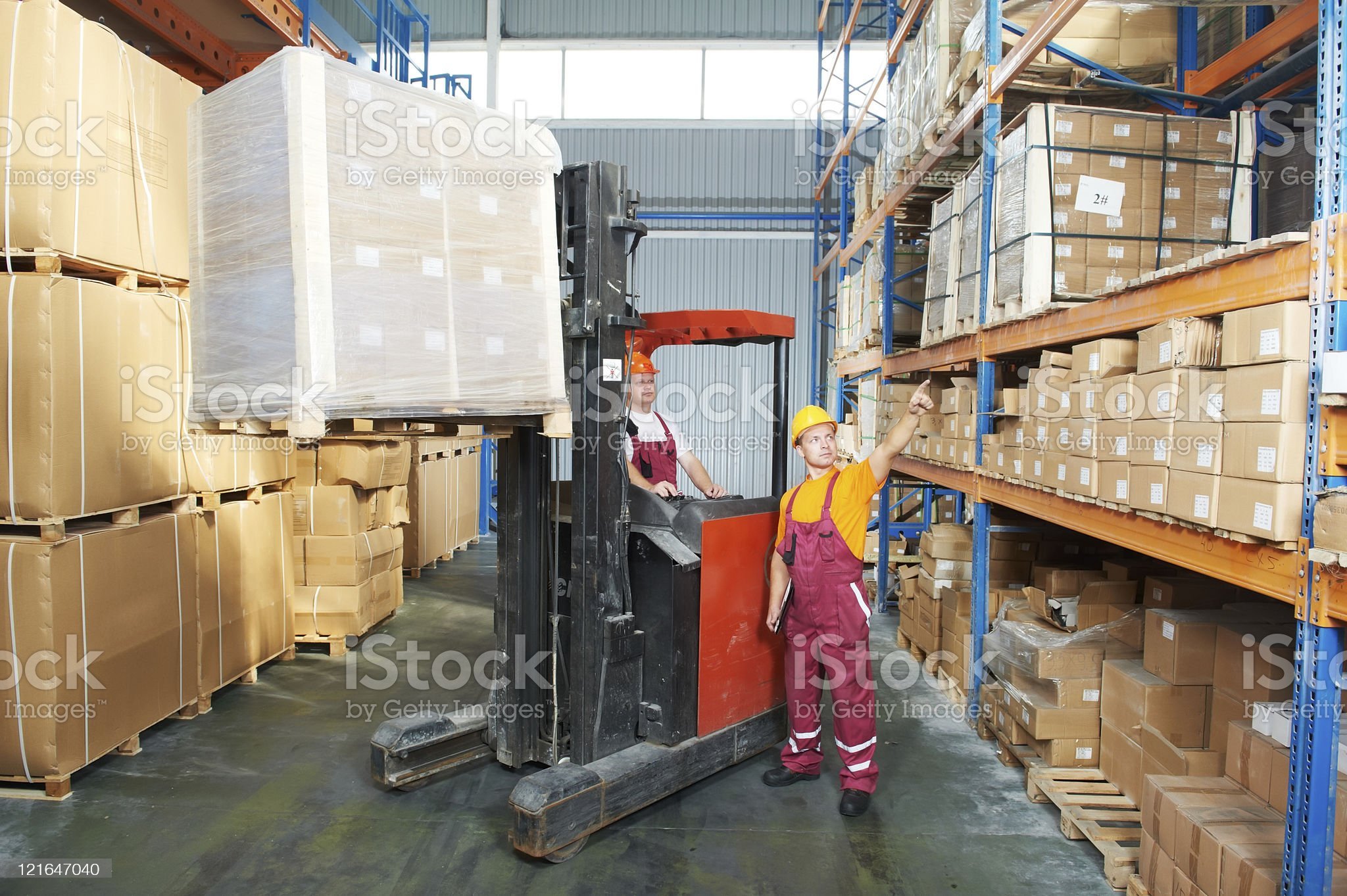 distribution in warehouse with forklift royalty-free stock photo