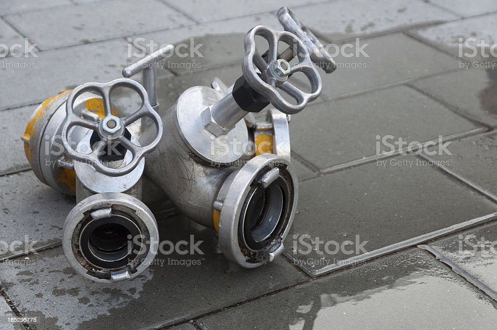 Distribution of the fire department on a gray floor stock photo