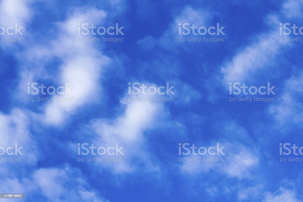 Distribution of white clouds on the clear blue sky royalty-free stock photo