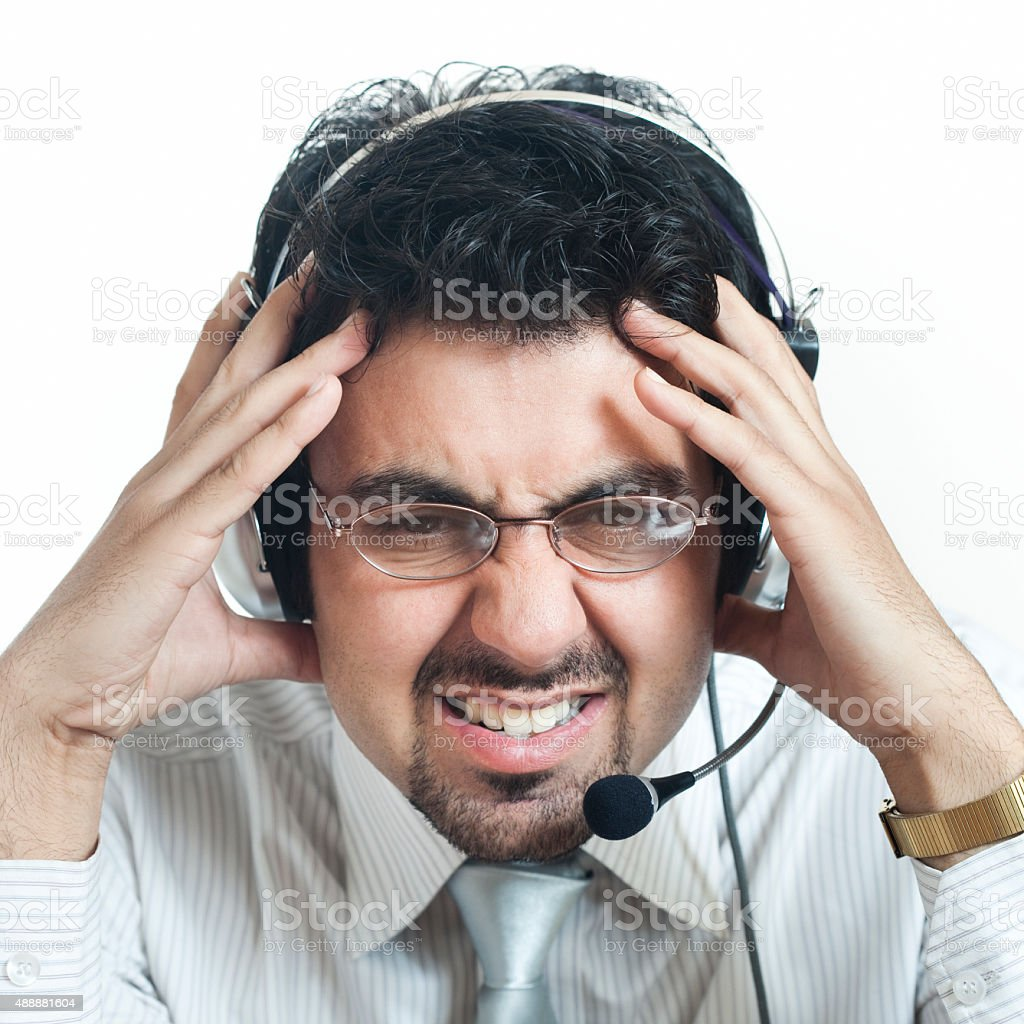 Disturbed customer care representative holding his head. stock photo