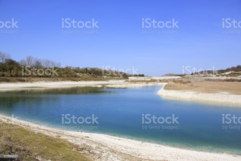 disused flooded cement works quarry royalty-free stock photo