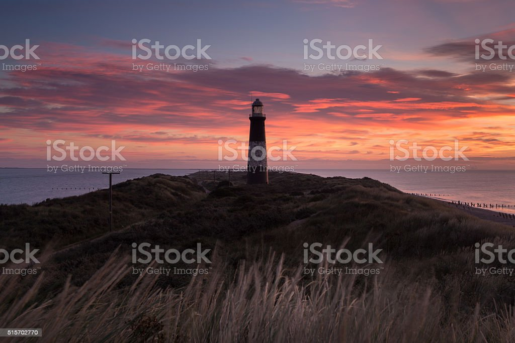 Disused lighthouse at dawn stock photo