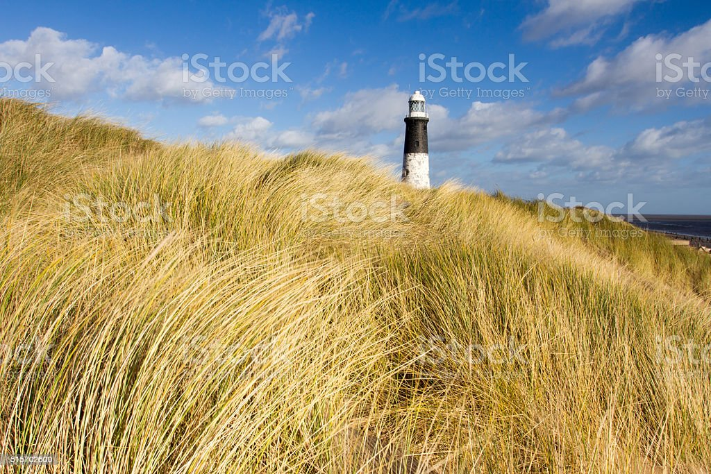 Disused lighthouse on a sunny day stock photo