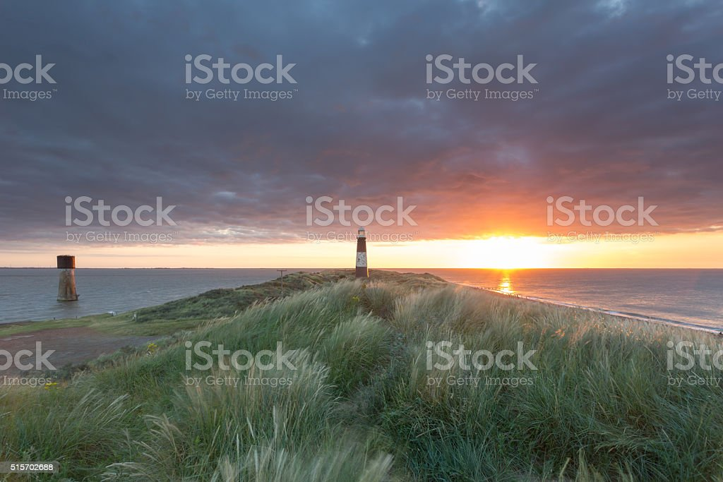 Disused lighthouses at dawn stock photo