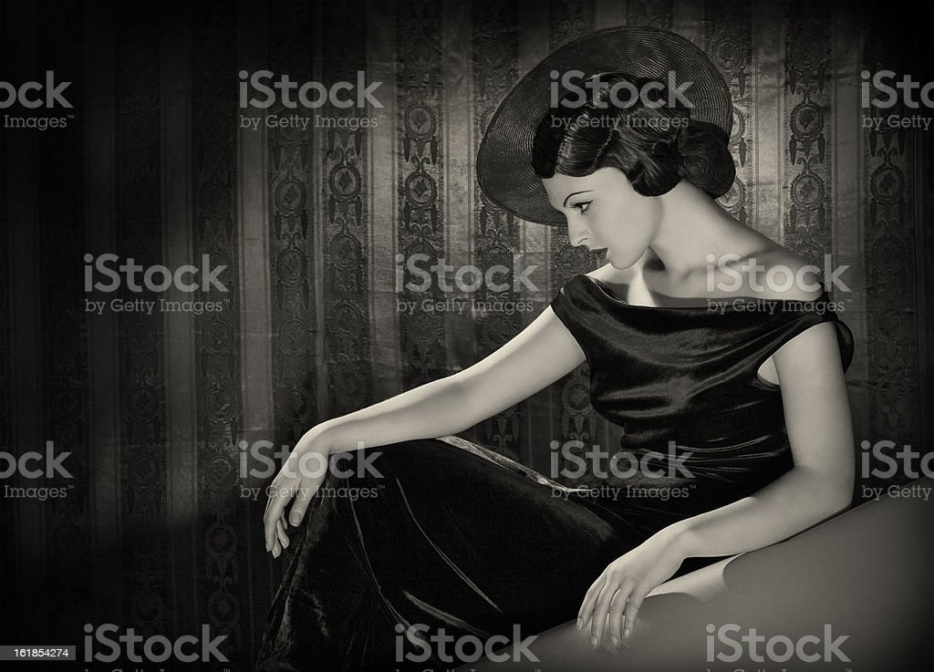 Diva with the hat in film noir style. stock photo