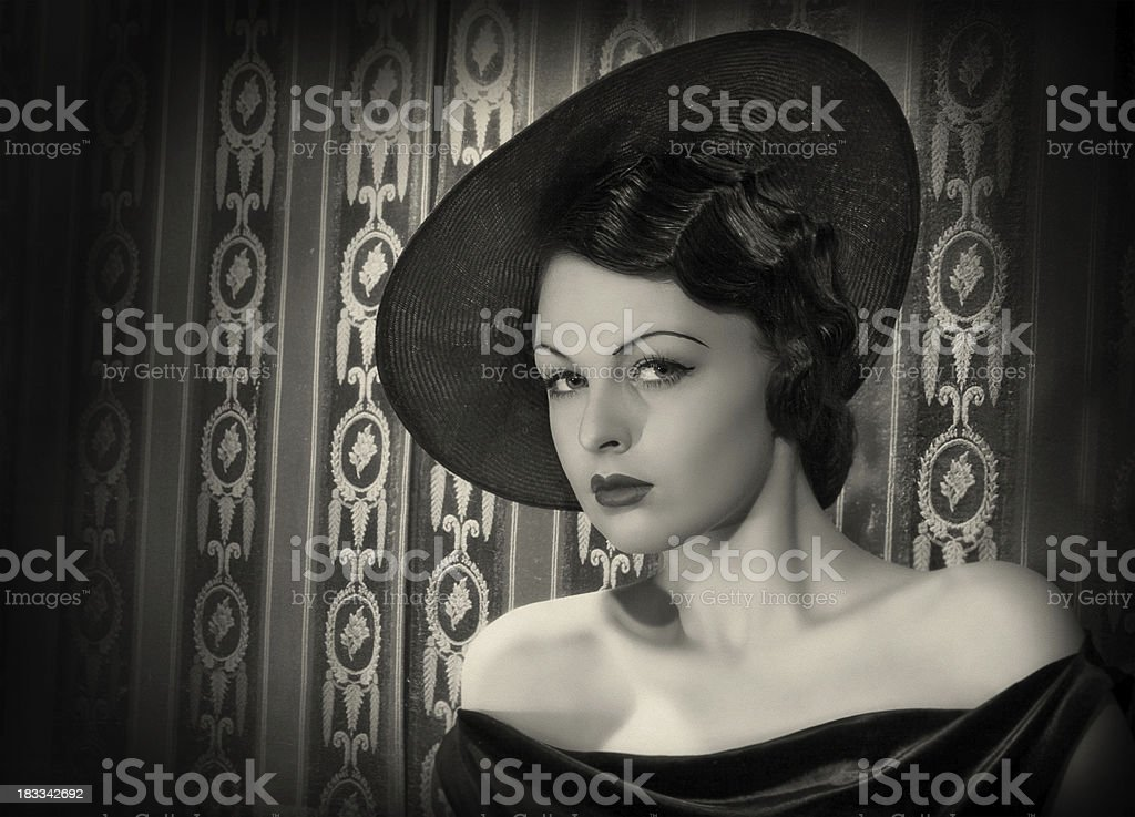 Diva with the hat in film noir style. royalty-free stock photo