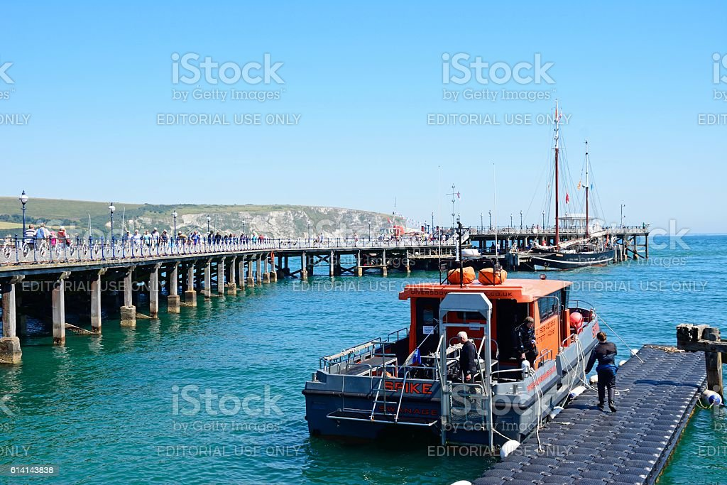 Dive boat and long pier, Swanage. stock photo