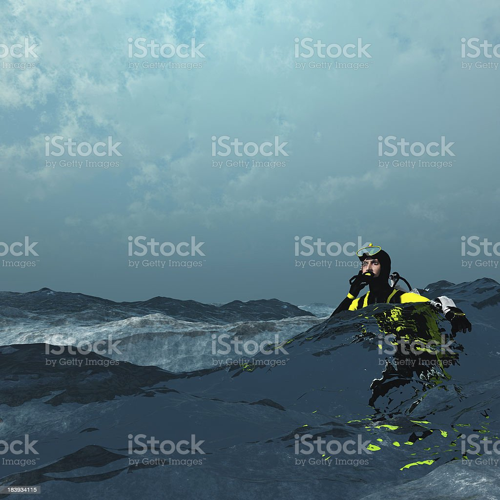Diver at surface of rough sea stock photo