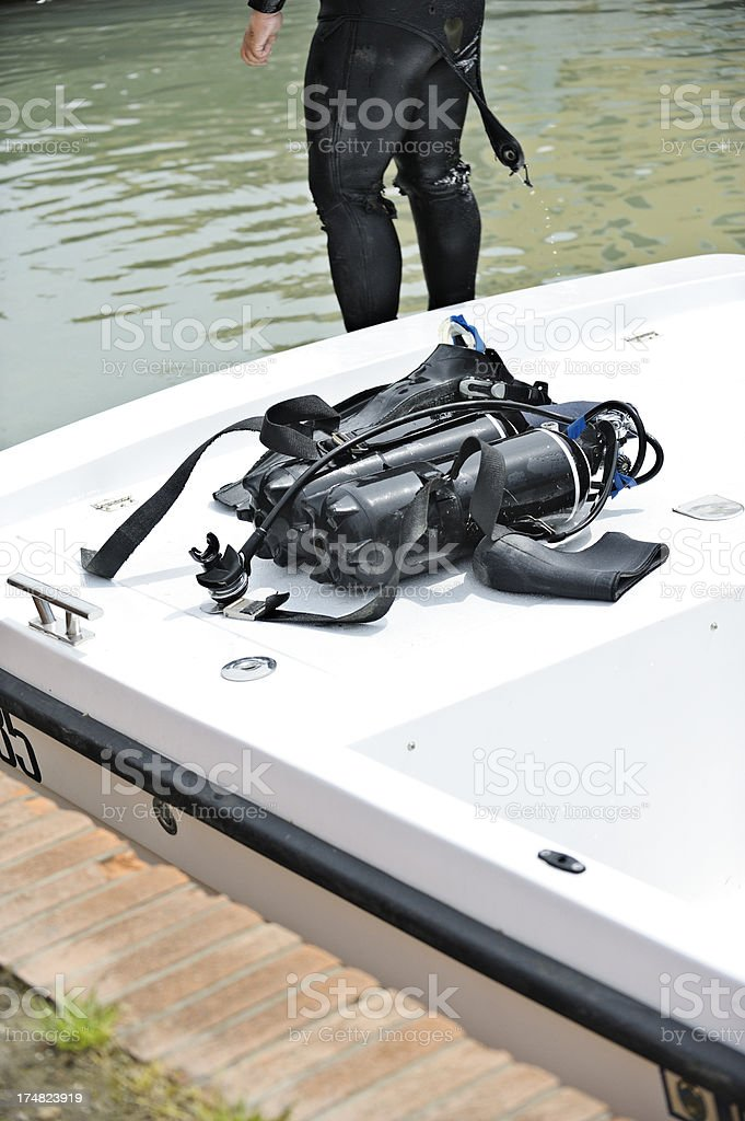 Diver beside equipment on boat stock photo