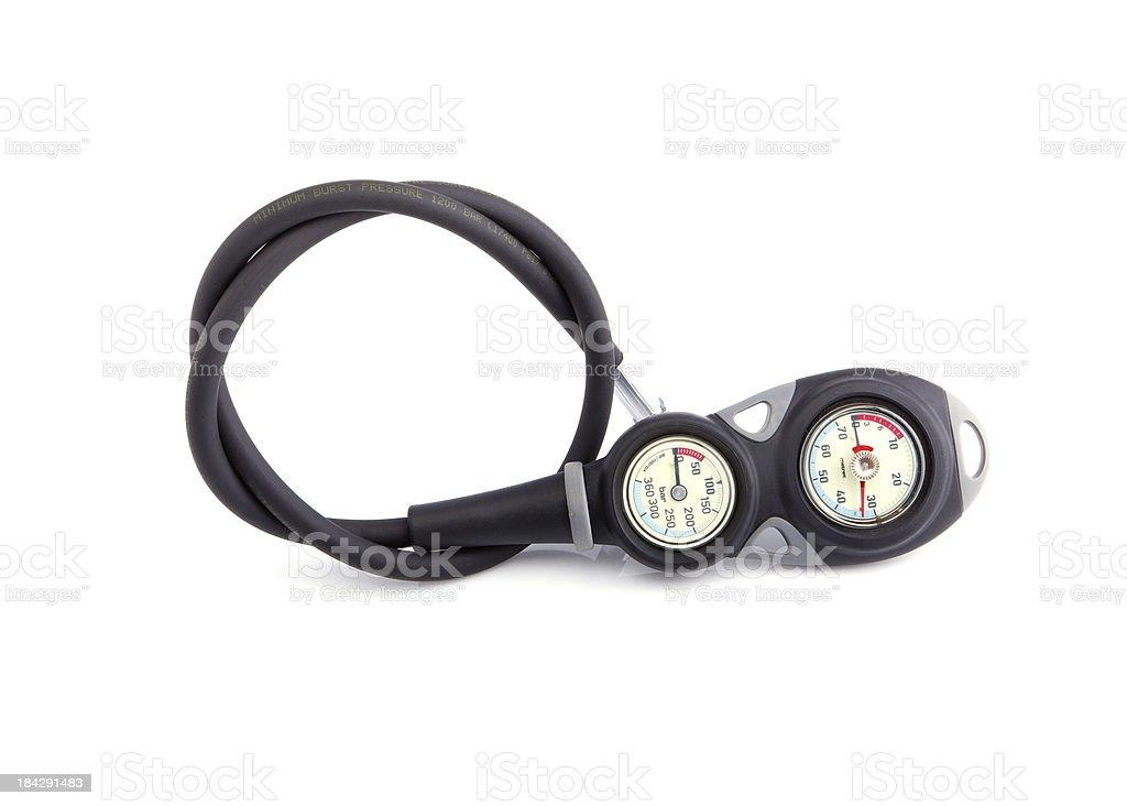 diver checking pressure stock photo