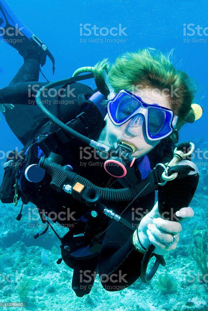 diver demonstrating scuba diving skills stock photo