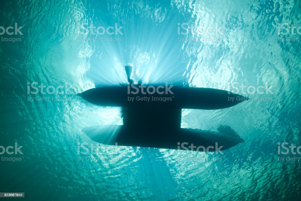 diver entering water stock photo