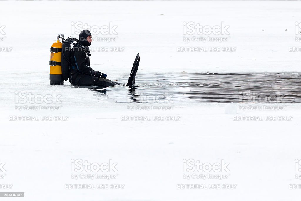 Diver ice cold water stock photo