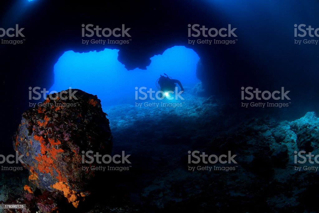 Diver in underwater cave stock photo