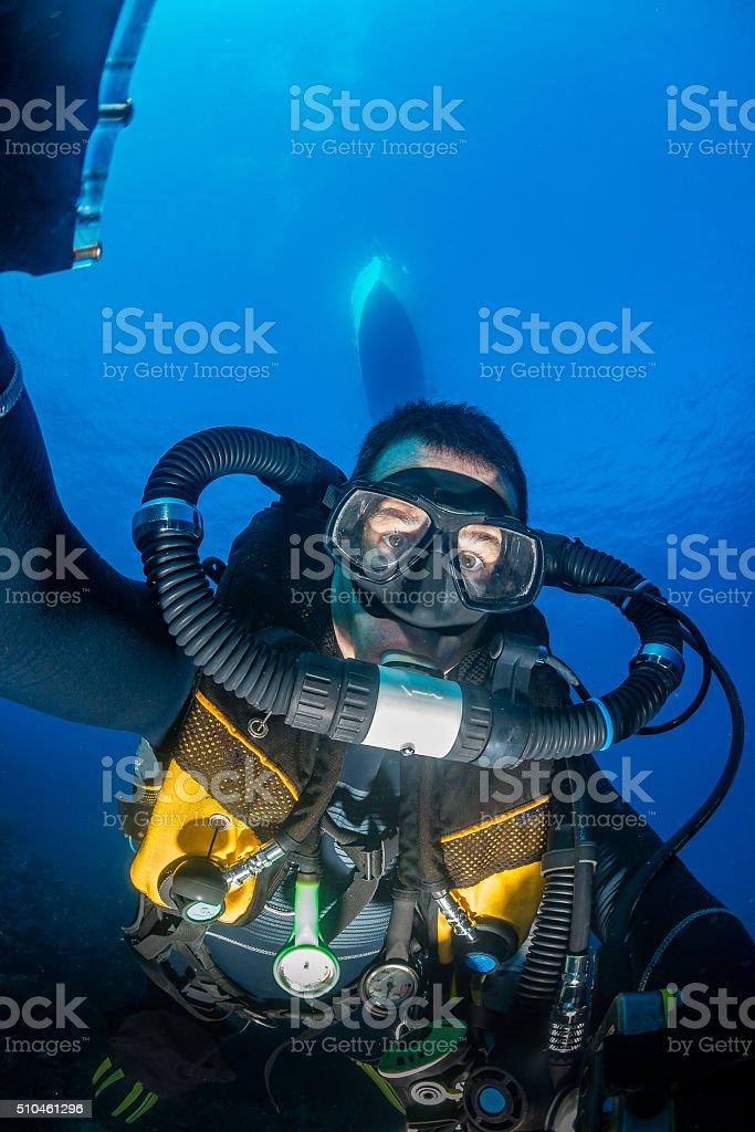 SCUBA diver on a closed circuit rebreather stock photo