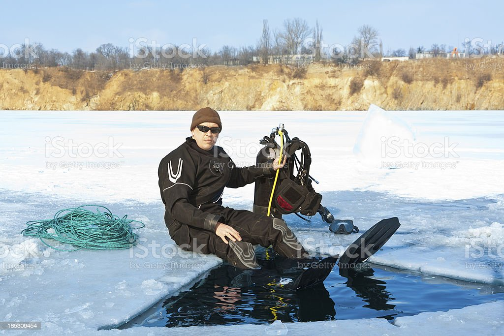Diver on the ice. stock photo