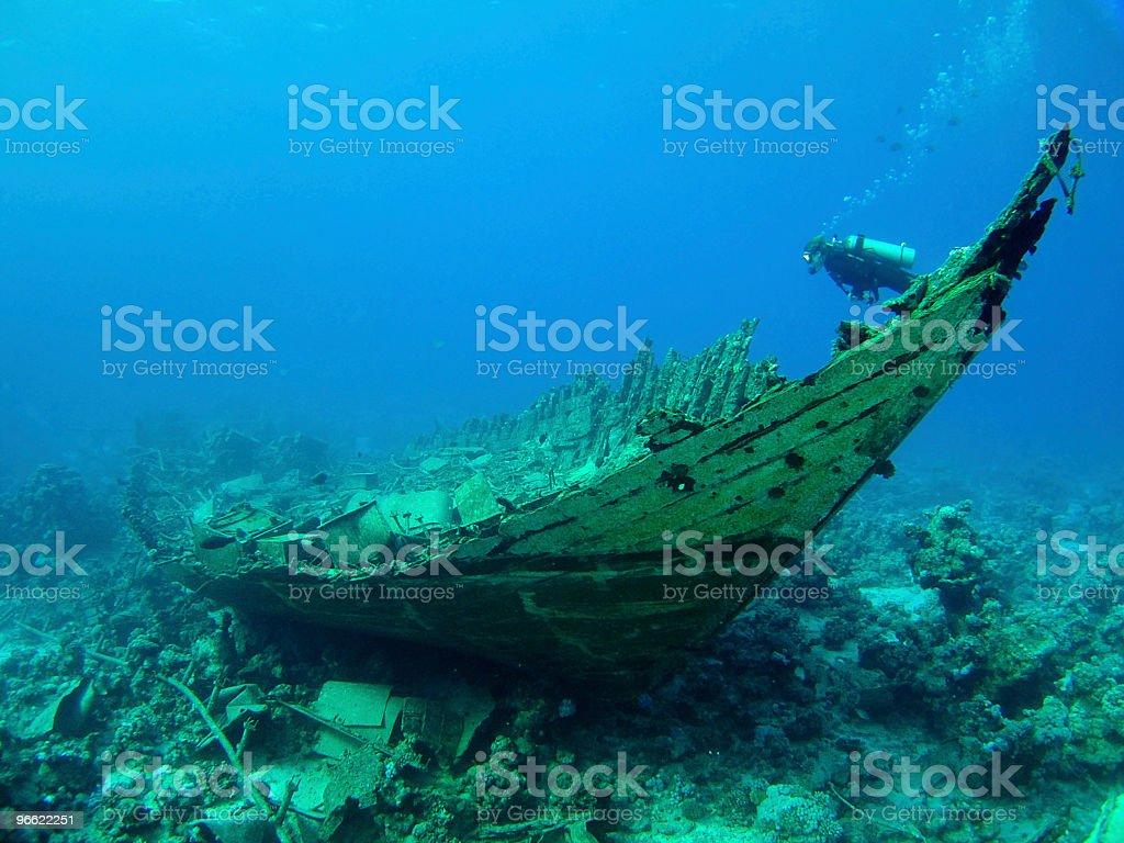 Diver over a wreck stock photo