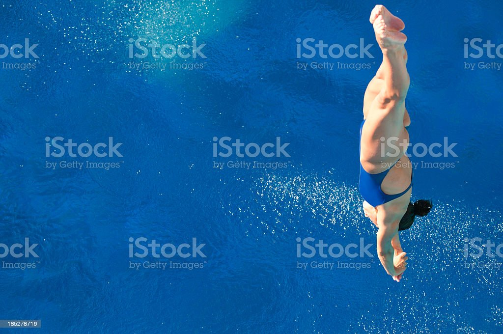 Diver plunging straight down toward the water royalty-free stock photo