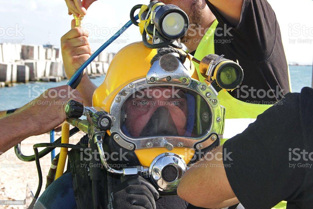 Diver preparing to dive stock photo