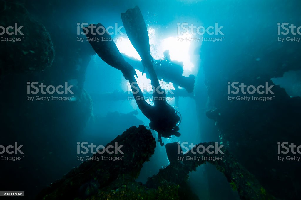 Diver Scuba Scubadiving Inside Sunken Ship stock photo