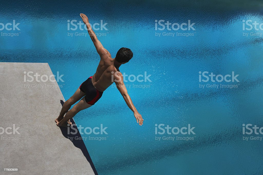 Diver standing on diving board stock photo