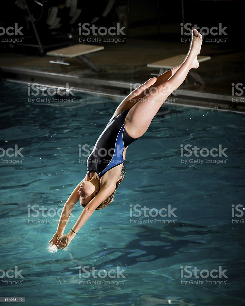 Diver Touching the Surface stock photo