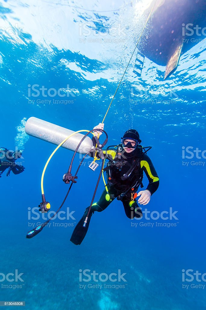 Diver with additional tank stock photo