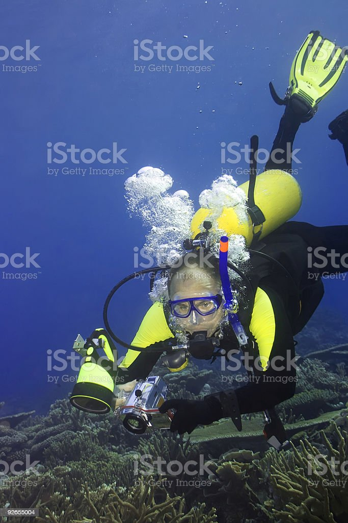 Diver with camera royalty-free stock photo