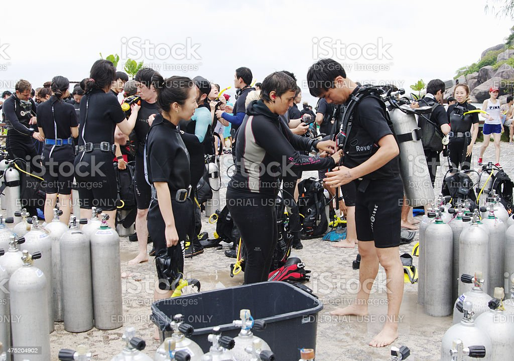 Divers preparing to dive, Koh Nanguan, Thailand. stock photo