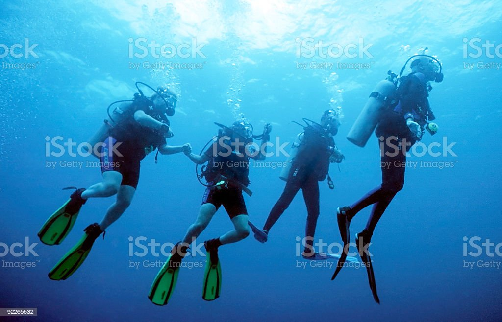 Divers Return stock photo