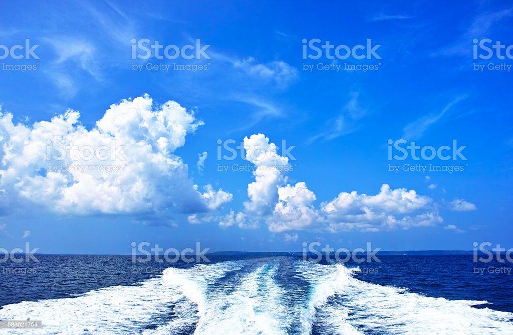 Divers ship wake stock photo