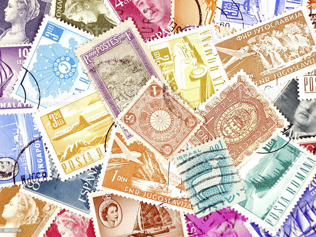Diverse and colorful postage stamps royalty-free stock photo