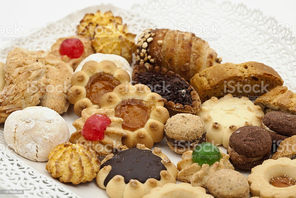 Diverse assortment of Italian cookies on white plate stock photo