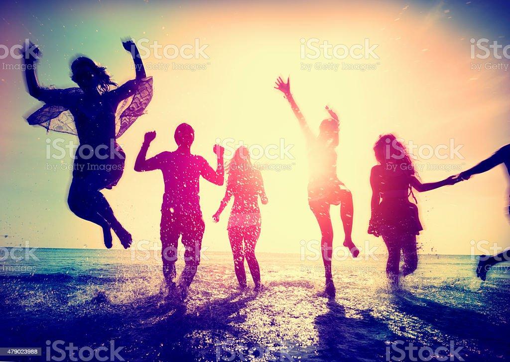 Diverse Beach Summer Friends Fun Running Concept stock photo