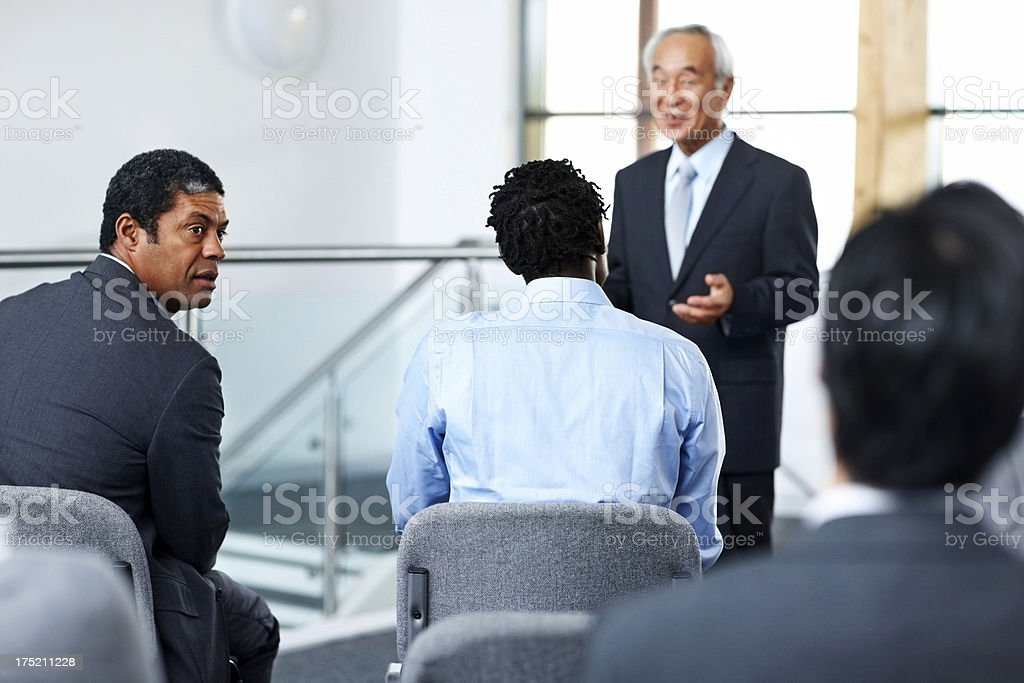 Diverse business group attending seminar royalty-free stock photo