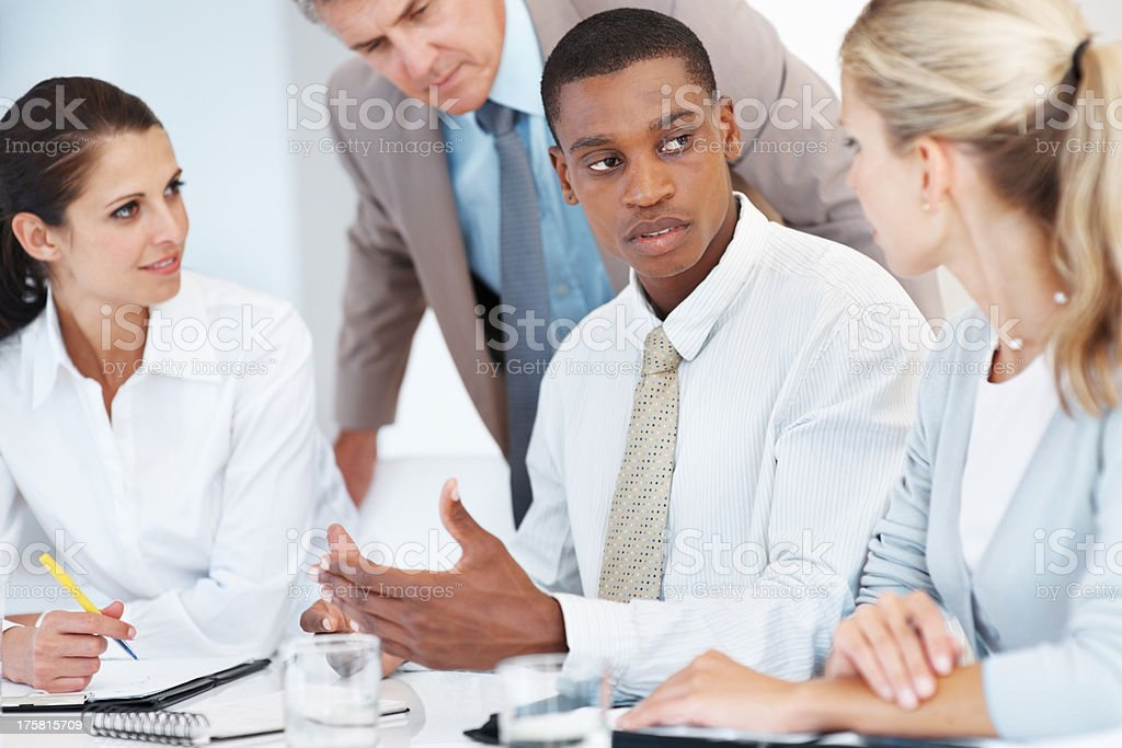 Diverse business group discussing work at office stock photo