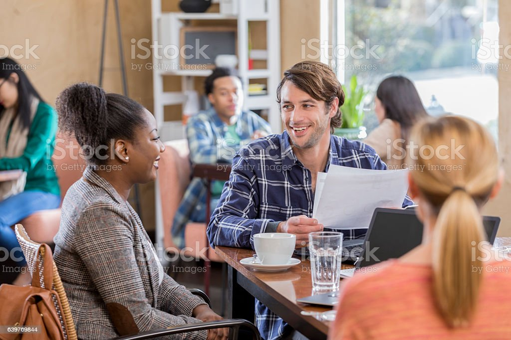 Diverse business team meets over coffee stock photo