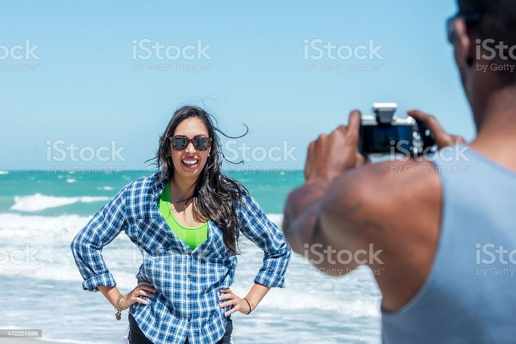 Diverse Couple Taking Pictures on Vero Beach stock photo