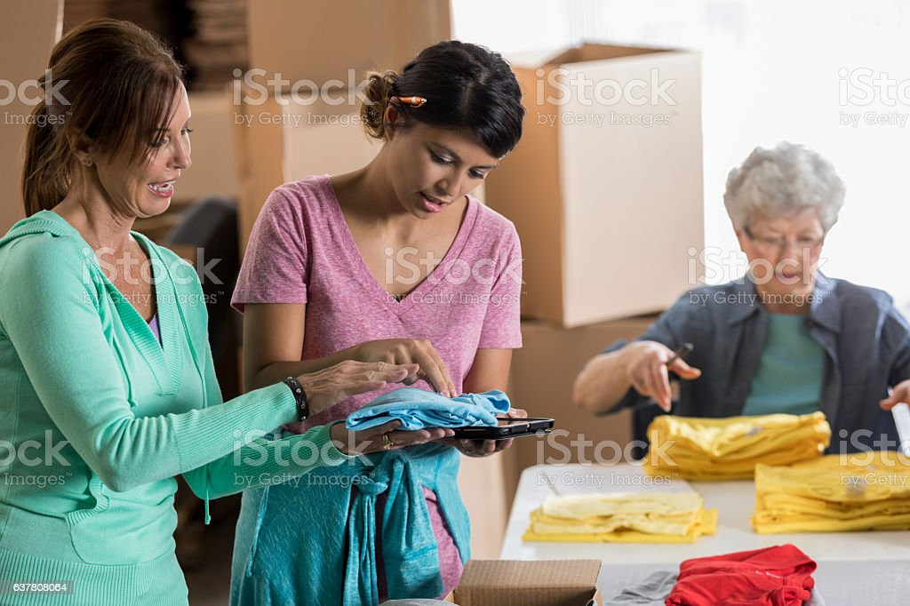 Diverse female small business owners check inventory and fill orders stock photo